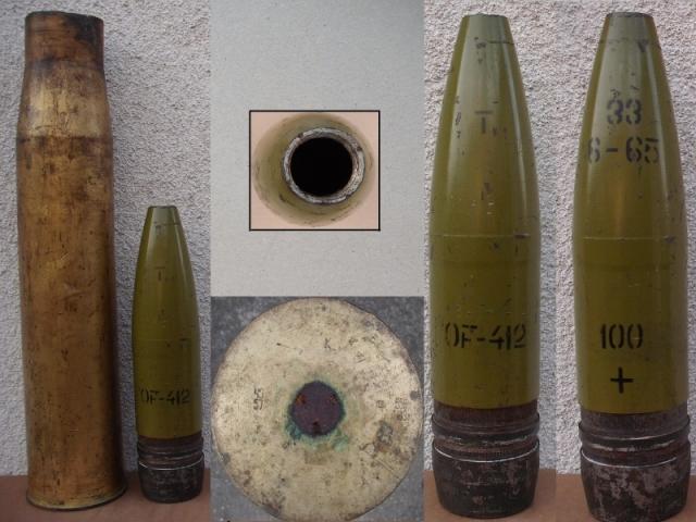 100 mm-es lövedék és lőszerhüvely a fémhulladék-gyűjtő telepről